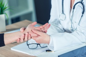 dermatologist inspects hand